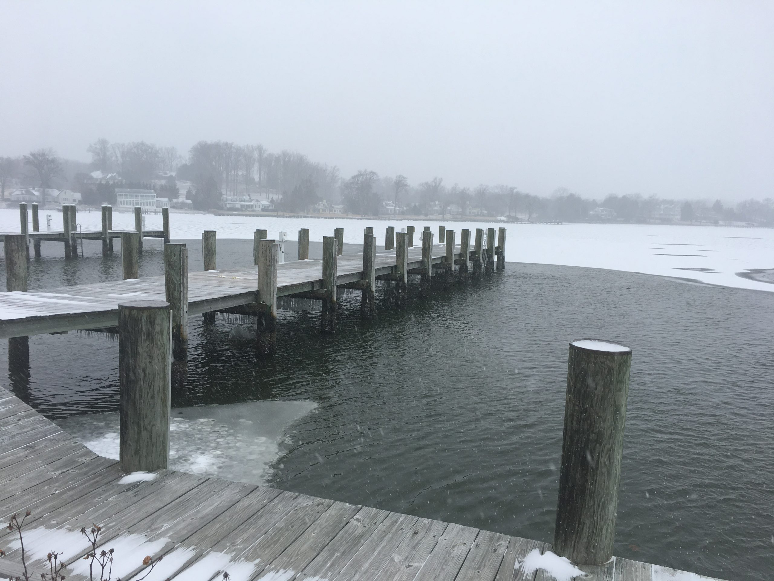 Wooden pier being protected from the lakes ice with an ice breaker